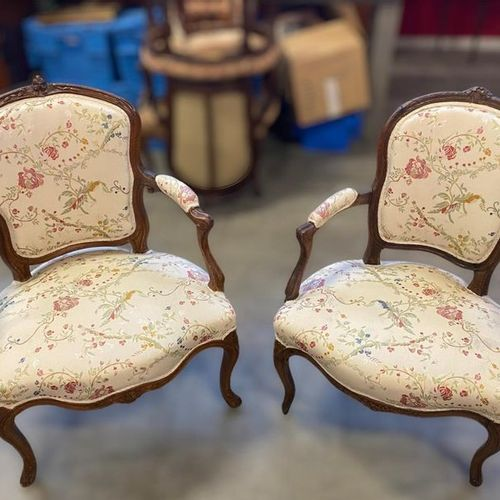 Two cabriolet armchairs in moulded and carved natural wood, one with an exploded…