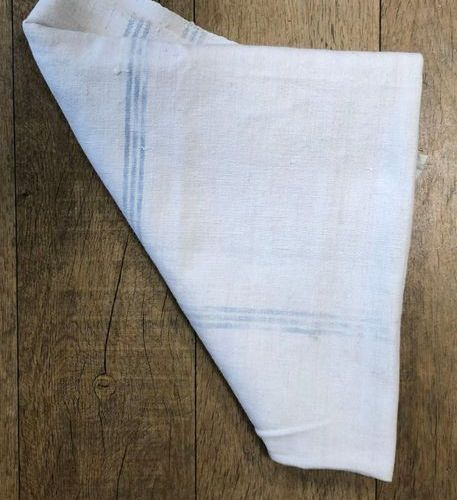 BREAD CLOTH in ecru woven linen with a light blue cross line pattern, the bottom…