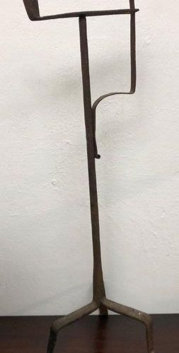 Wrought iron RESINER resting on a tripod base decorated with a cross with a syst…