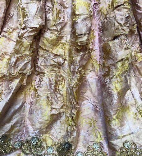 RARE COMPLETE WOMEN'S SET consisting of a billiard green woollen petticoat, deco…