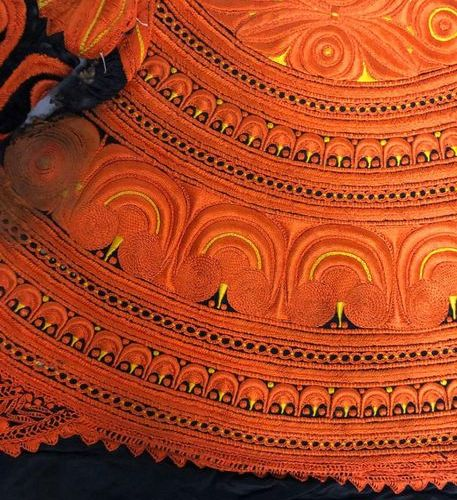 TWO ELEMENTS embroidered on woollen cloth with orange and yellow silk threads, c…