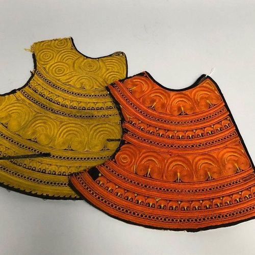 TWO PLASTERS in yellow silk thread for one and orange for the other. (some stain…