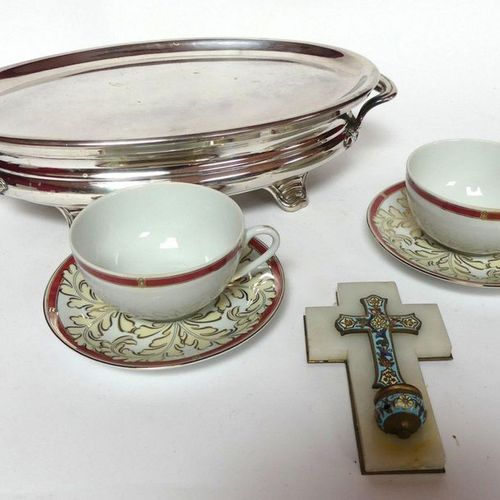 An oval FLAT HEATER in silvery metal. CHRISTOFLE a pair of breakfast cups and en…