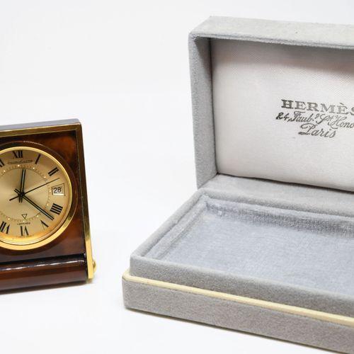 "JAEGER LECOULTRE for HERMES.  Travelling clock ""Ados mignonette"", the gilded dia…"