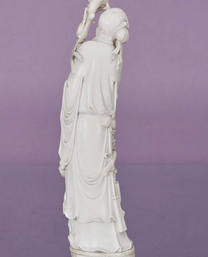 CHINE Topic    In ivory representing Shoulao holding a branch with peaches and h…