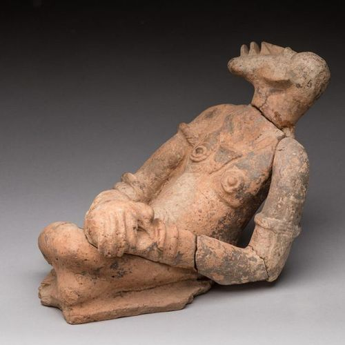 DJENNE, Mali.  Terracotta with light slip.  Statuette of a seated character lean…