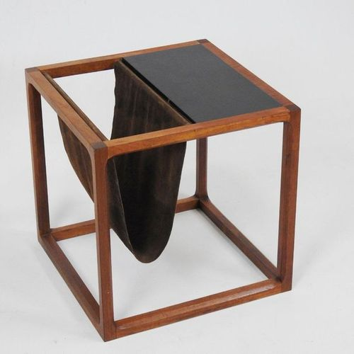 Aksel KJAERSGAARD (20th century)  End of sofa forming a magazine rack in wood an…
