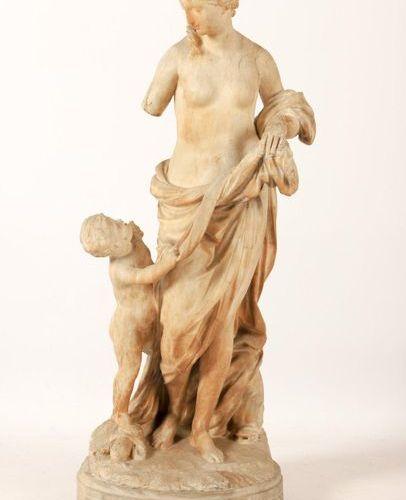 GROUPEen albâtre sculpté en ronde bosse représentant Vénus et Cupidon. Debout s…