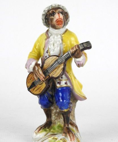 SUBJECT in polychrome porcelain representing a musician monkey. Mark on the reve…