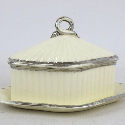 LANGEAIS : butter dish covered with diamond shaped earthenware on a shuttle. The…