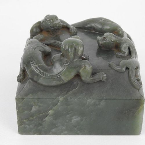 CHINA: Green jade seal decorated with three Fô dogs. No imprint. Height: 7 cm ; …