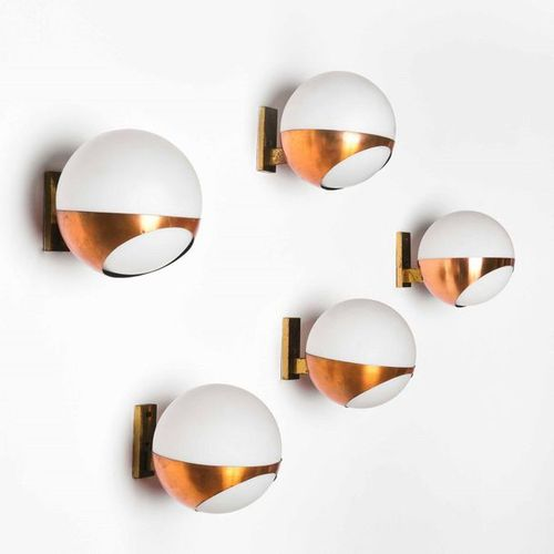 Stilnovo, Five brass wall lamps. Diffusers in opal glass. Manufacture by Stilnov…