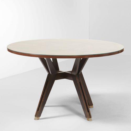MIM, Tavolo rotondo con struttura e piano in legno. Dettagli in metallo. Prod. M…