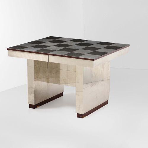 Ross Littell, Tavolo con struttura e sostegni in legno rivestiti in acciaio, pia…