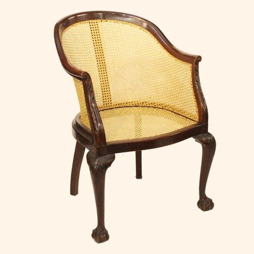 CHIPPENDALE STYLE MAHOGANY OFFICE CHAIR WITH CANE SEAT