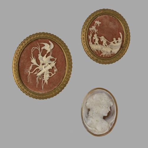 Set including two finely carved ivory medallions, a scene depicting men pulling …