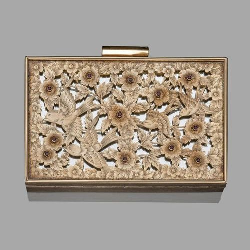 CORKER. Circa 1940.  Rectangular shaped minaudiere in gadrooned silver, the lid …