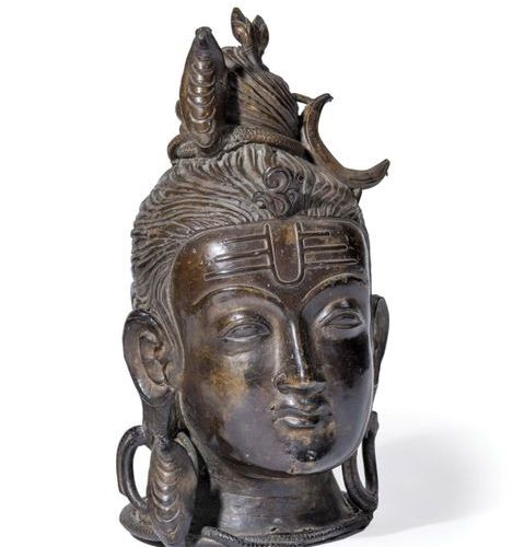 Bronze Shiva head, wearing a naja and the crescent moon.  Indian work. Late 19th…