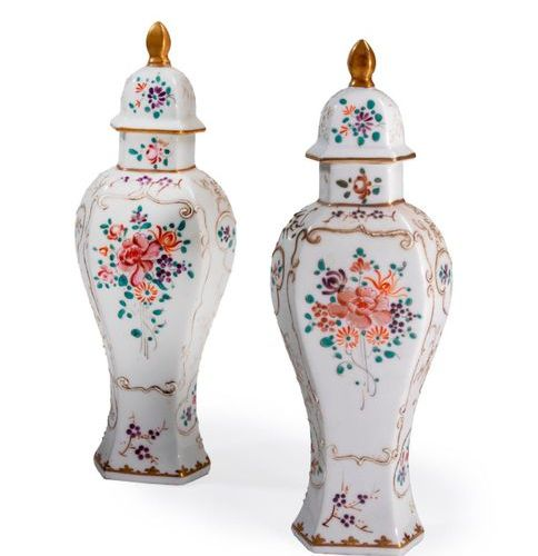 Pair of covered porcelain vases decorated with flowers and foliage.  Japan, 20th…