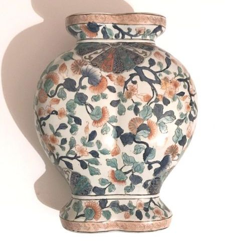 Japan. Meiji period.  Double bellied porcelain vase decorated with polychrome en…