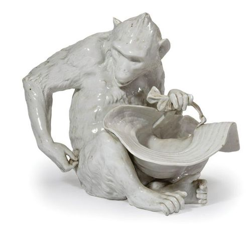 Sitting monkey holding a hat.  White enameled porcelain group.  Late 19th centur…