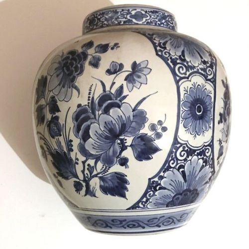 Pair of ginger pots covered in Delft earthenware decorated in monochrome blue of…