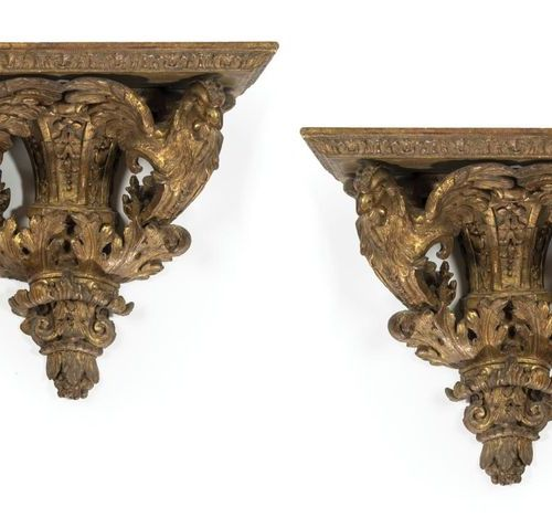Pair of carved, stuccoed and gilded wood sconces formed by a sheath of foliage i…