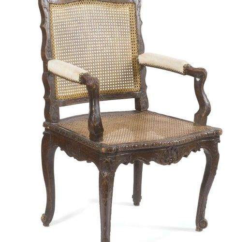 Suite of four beechwood queen armchairs moulded and carved with shells and leafy…