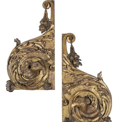 Pair of gilded wood panelling elements, formed by a large leafy scroll decorated…