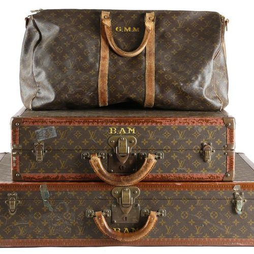 TWO LOUIS VUITTON CANVAS SUITCASES c.1960 with brass mounts and locks, leather e…