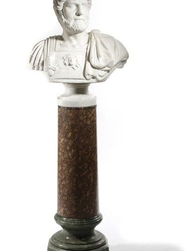 AFTER THE ANTIQUE. A WHITE MARBLE BUST OF THE ROMAN EMPEROR HADRIAN on a turned …