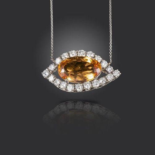 An orange topaz and diamond pendant, the oval shaped topaz set within a lozenge …