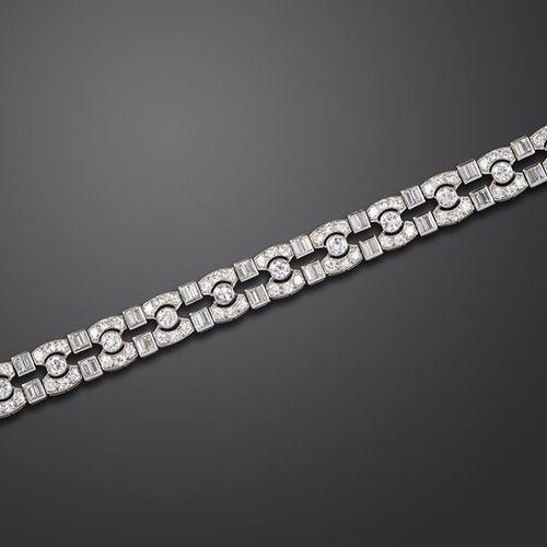 An Art Deco diamond bracelet, mounted with graduated circular cut and baguette s…