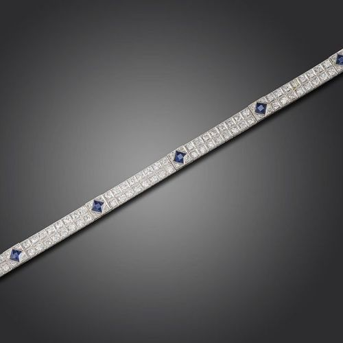 An Art Deco sapphire and diamond bracelet, set with pairs of old circular cut di…