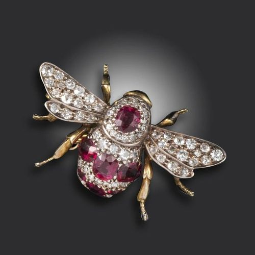A late Victorian diamond and ruby set bee brooch, realistically formed and pave …