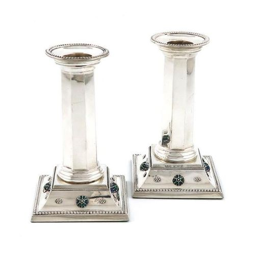 By Liberty and Co, a pair of Edwardian silver and enamel candlesticks, Birmingha…