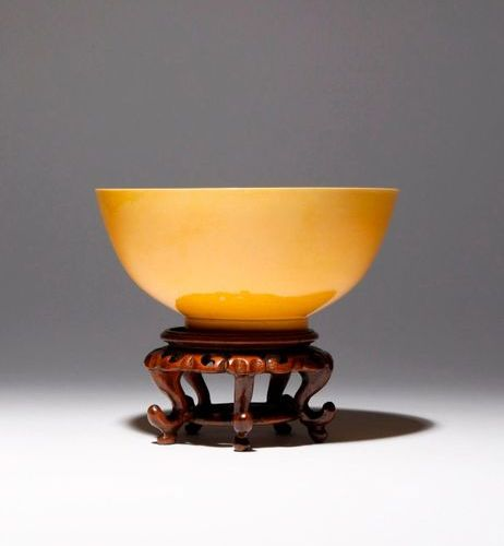 A CHINESE IMPERIAL YELLOW GLAZED BOWL SIX CHARACTER KANGXI MARK AND OF THE PERIO…
