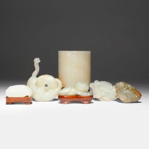 A GROUP OF SEVEN CHINESE JADE ITEMS 18TH/19TH CENTURY Comprising: a pale celadon…