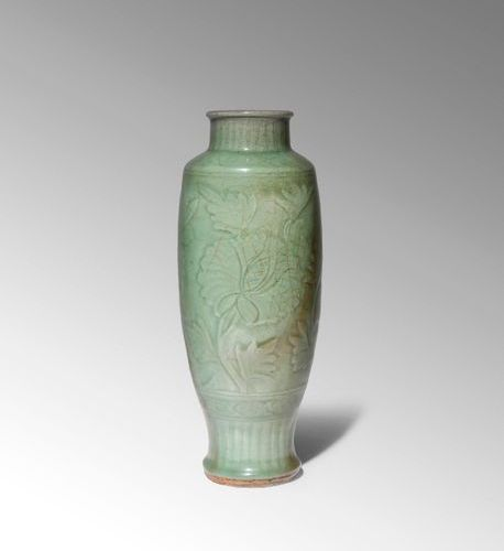 A CHINESE LONGQUAN CELADON VASE MING DYNASTY The tall ovoid body supported on a …