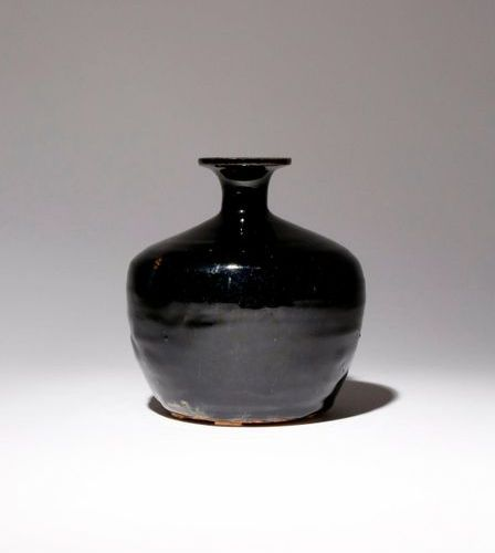 A CHINESE BLACK GLAZED VASE PROBABLY SONG DYNASTY The stout body tapering gently…