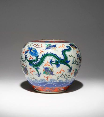A CHINESE WUCAI 'DRAGON' VASE 19TH CENTURY The ovoid body brightly painted with …