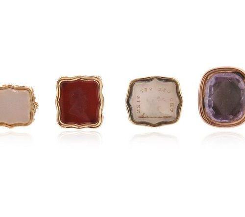 A set of six miniature fob seals, including a gold fob seal, the amethyst matrix…