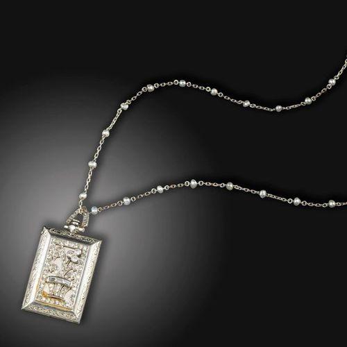 An Art Deco diamond set travel clock pendant, the rectangular pendant case appli…