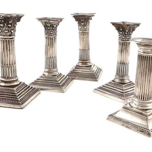 A pair of silver candlesticks, by Garrard and Co., Sheffield 1966, Corinthian co…