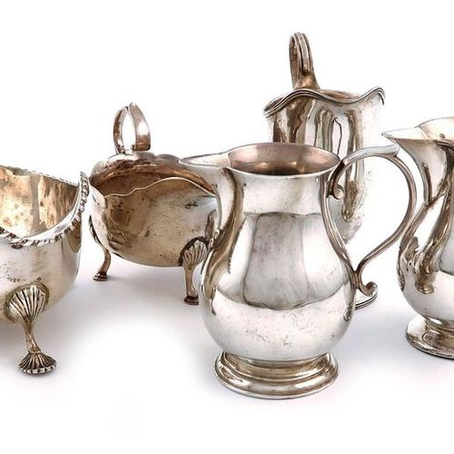A mixed lot of silver items, various dates and makers, comprising: two cream jug…