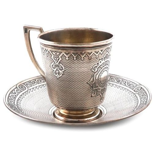 A 19th century Russian silver cup and saucer, assay master Viktor Savinkov, Mosc…