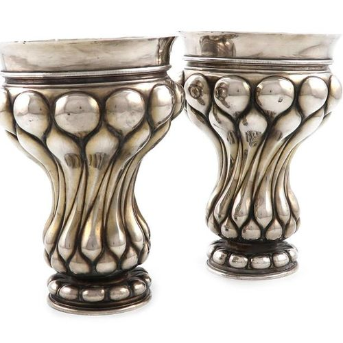 A pair of continental silver beakers, bearing pseudo 18th century Russian marks,…