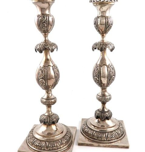 A pair of late 19th century Russian silver candlesticks, maker's mark possibly M…