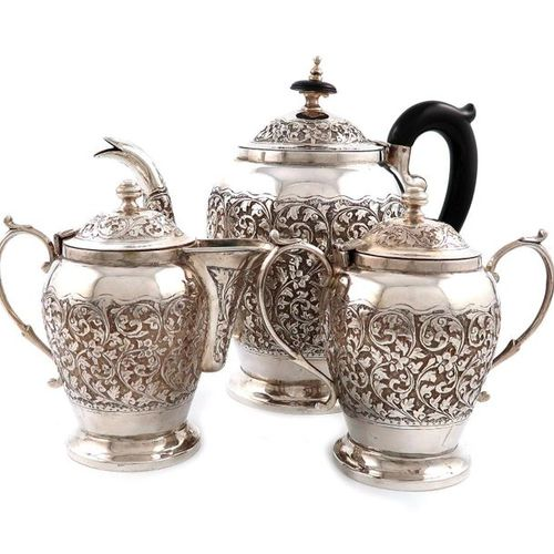 A three piece Indian metalware tea set, unmarked hinged covers, baluster form, c…
