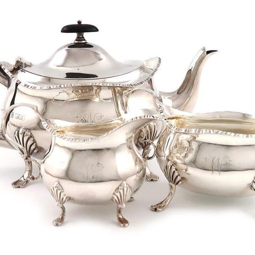 A three piece Edwardian silver tea set, by William Hutton and Sons, London 1904/…
